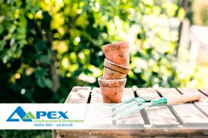 Landscaping tips to Prevent Basement Flooding - Pots and trowel pictured